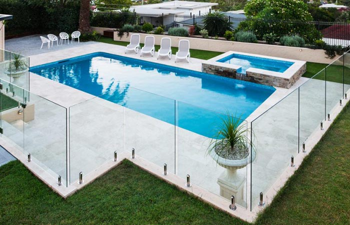 Enhance the beauty of your swimming pool with aluminum and glass pool fencing
